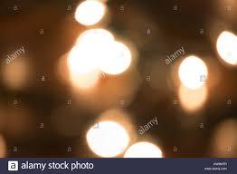 bright white christmas lights bright white christmas lights on a blurry christmas tree stock photo