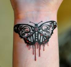 evil butterfly tattoos on wrist amazing ideas