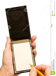 blank paper to write hand with pencil writing in small blank notebook stock photo royalty free stock photo