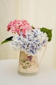 vintage can vase for flower arrangement minimalist flower on table