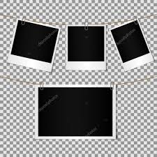 set of blank photo polaroid frame attached by paper clip to cord