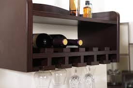 floating wall wine rack with glass holder underneath in espresso