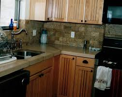 bathroom lowes counter tops with tile backsplash and pendant lamp