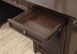 power outlet writing desk in dark brown finish by coaster 801097