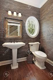 powder room in luxury home with circular window stock photo