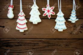 many cookies with different decorations hanging on