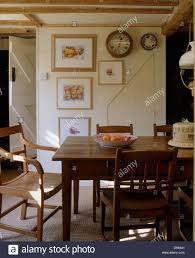 antique oak table and wooden chairs in simple cottage dining room
