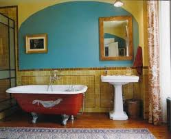 bathroom renovation ideas with painted red clawfoot tub and framed
