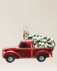 bringing home a christmas tree red pick up truck with christmas