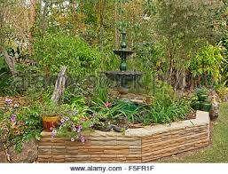 decorative garden feature with low stone wall ornate fountain