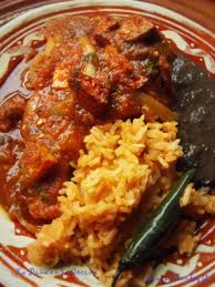 chuletas de puerco en salsa pork chops braised in a fresh tomato