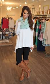 white shirt black leggings brown boots and mint green scarf