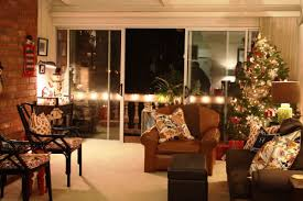 christmas living room night hang white socks light brown chair