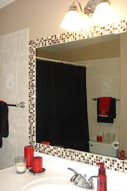 simple way to dress up a plain bathroom mirror add tile for