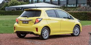 yellow toyota 2015 toyota yaris pricing and specifications photos 1 of 10