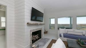 fireplace bookshelves vaulted ceiling mapo house and cafeteria