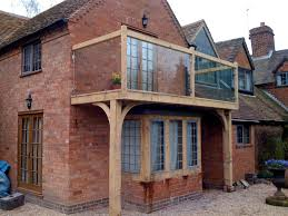 green oak balcony and windows traditional conservatories ltd
