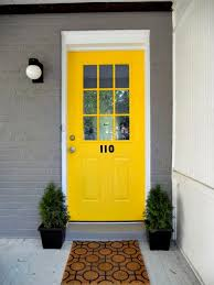 yellow front door grab their attention with the bright yellow greeting for your entry