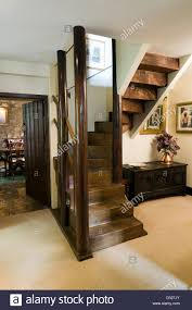 an arts and crafts style staircase in a cottage entrance hall