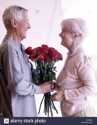 present for 60 year woman senior citizen s bunch of roses eye contact at the