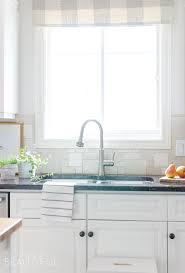 easy kitchen upgrade our new kitchen faucet a burst of beautiful a sleek new pull down faucet adds a touch of modern simplicity to this white