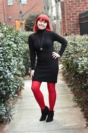 work turtleneck sweater dress with red tights and wedge boots
