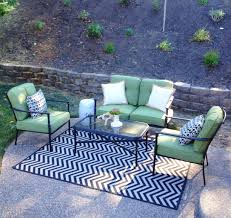 patio lounge area furniture from lowe s indoor outdoor rug from furniture from lowe s indoor outdoor rug from ballards outdoor pillows from target and tuesday morning