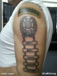military skull tattoo on biceps
