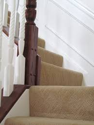 interior red stair runner with border on brown laminated wooden