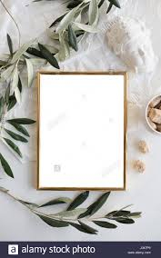 golden frame mock up on white tabletop background home decor