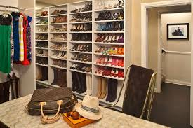 traditional closet with hardwood floors by jeneration interiors