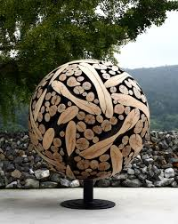 wood sculptures created out of discarded tree trunks and branches