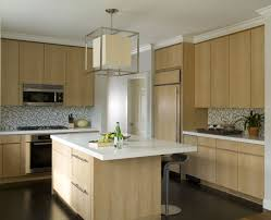 kitchen with light wood cabinets light fixtures