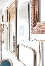 gallery wall of frames u0026 mirrors french country cottage