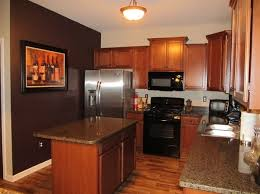 wine kitchen decor with framed wine photo and dark brown paint