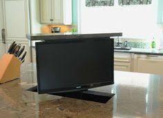 kitchen television ideas tv in kitchen between size refrigerator and size freezer