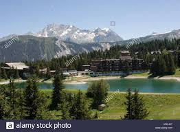 hotel by lake above courchevel 1850 in the french alps near the