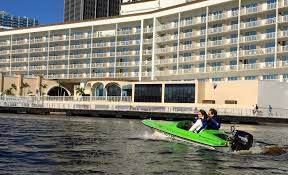 company lets tourists locals explore tampa s waterways tbo com sean bowes michael kahn and adriana matutino on their half hour boat rental from riverwalk