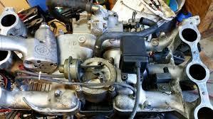 subaru svx engine subaru small black box located under intake manifold motor