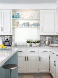 this white cottage kitchen is a cozy space with light blue accents