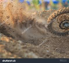 motocross race track motocross racer accelerating dirt track details stock photo