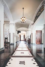 the king s palace the front hall on the first floor features archways columns marble floors and