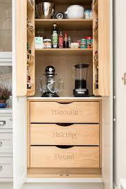 Light Gray Kitchen Pantry Cabinets Open To Labeled Drawers