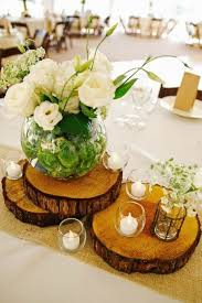 wood centerpieces 37 ways to use wood slices at your wedding weddingomania