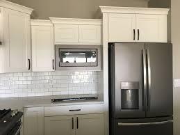 white kitchen cabinets with black slate appliances built in microwave slate appliances white cabinets slate