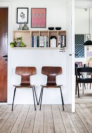 cozy scandinavian villa full of retro design mixed sign fritz hansen chairs wall art bookshelf nordic home
