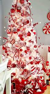 white tree with and silver decorations happy holidays