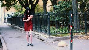 halloween city game cosplayer in scary halloween of in bloody red dress alma