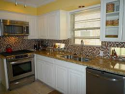 ideas grey glass mosaic tile backsplash with metal kitchen sink special wooden cabinets design as wells as granite counter feat large metal sink faucet with