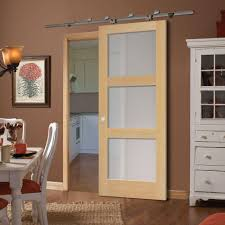wood barn door slabs barn decorations by chicago fire primed 3 lite equal solid wood interior primed 3 lite equal solid wood interior barn door slab 82062 the home depot